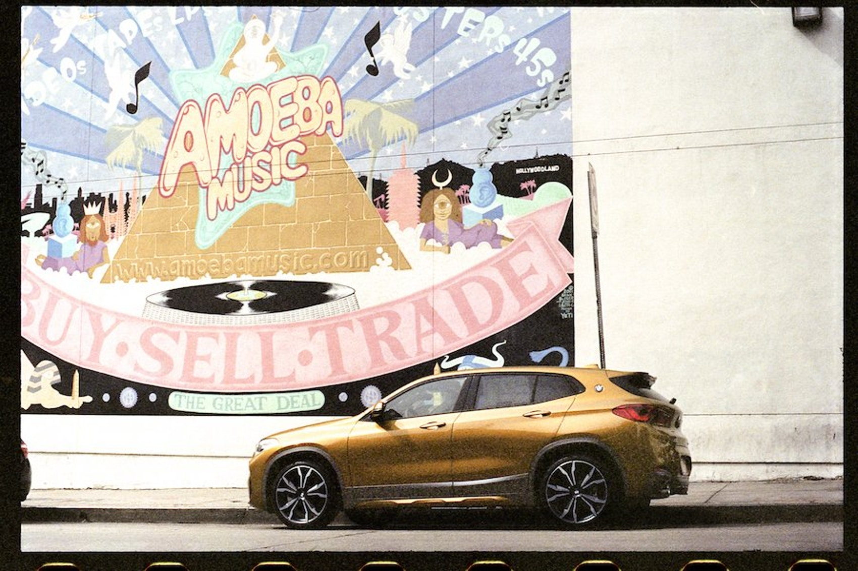 The first-ever BMW X2 pictured in front of the legendary Amoeba Records.